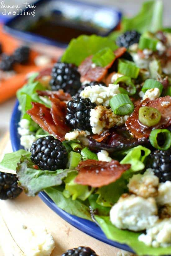 Close up of Blackberry, Bacon & Blue Cheese Salad in a blue bowl.