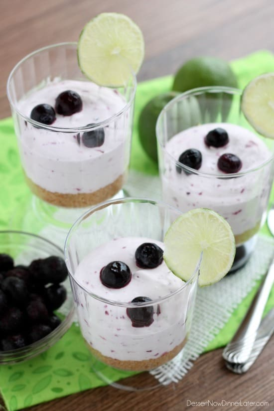 Blueberry Lime No-Bake Cheesecake Cups with fresh lemon and blueberries on the side.