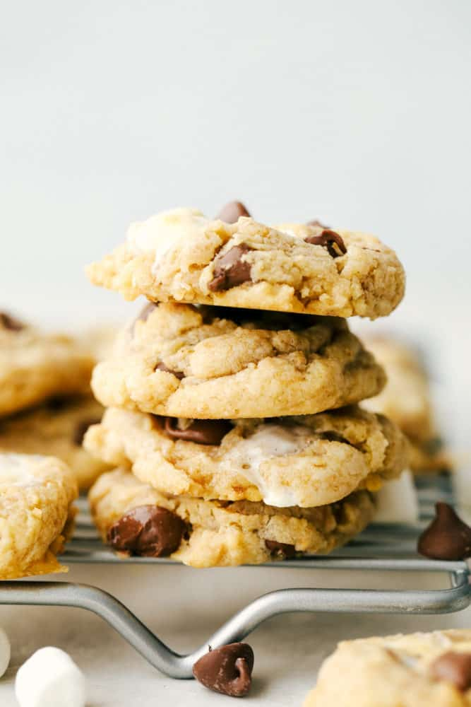 Gooey S'mores cookies stacked on top of each other resting on a cooling rack.