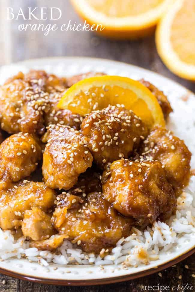 Baked orange chicken overtop of rice in a white bowl.