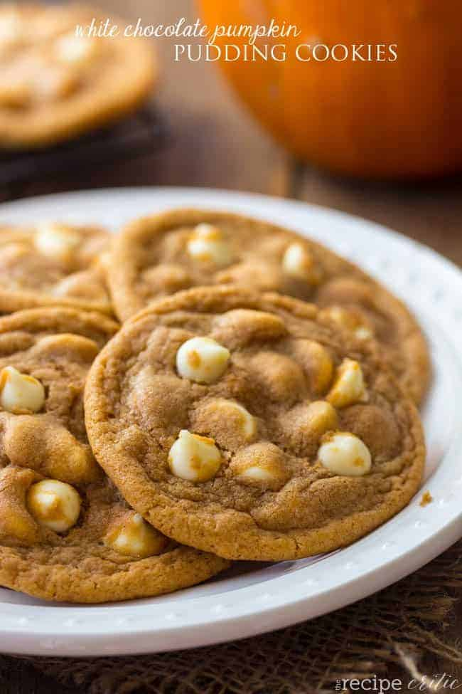 White chocolate pumpkin pudding cookies on a white plate.