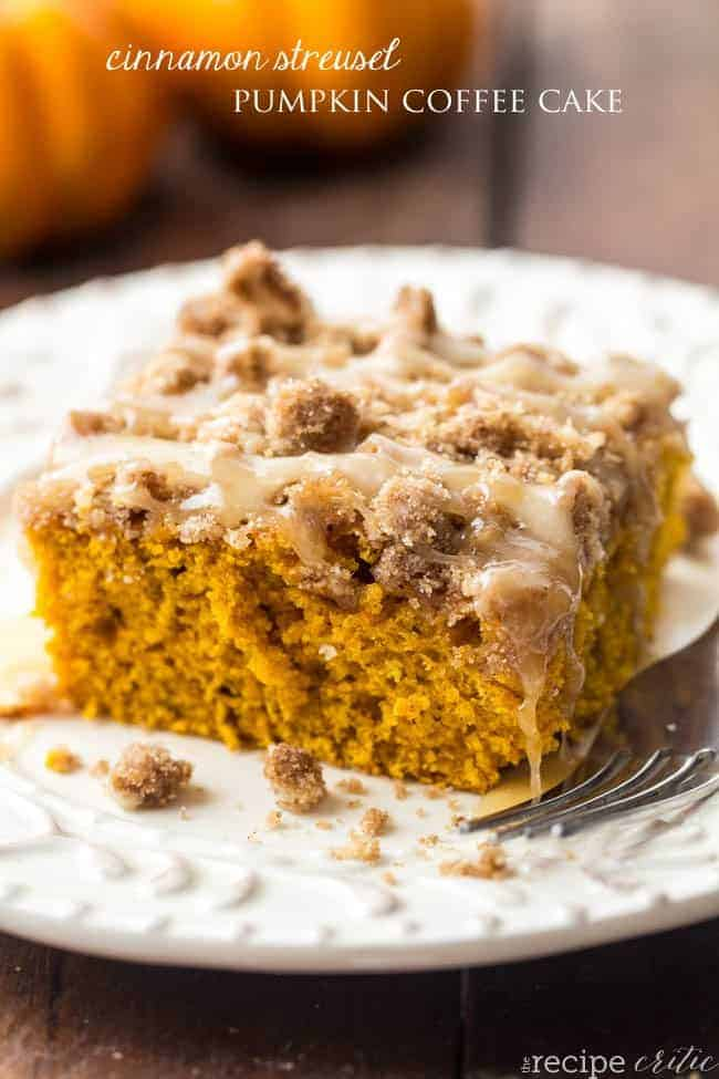 Cinnamon streusel pumpkin coffee cake on a white plate with a fork on the side.