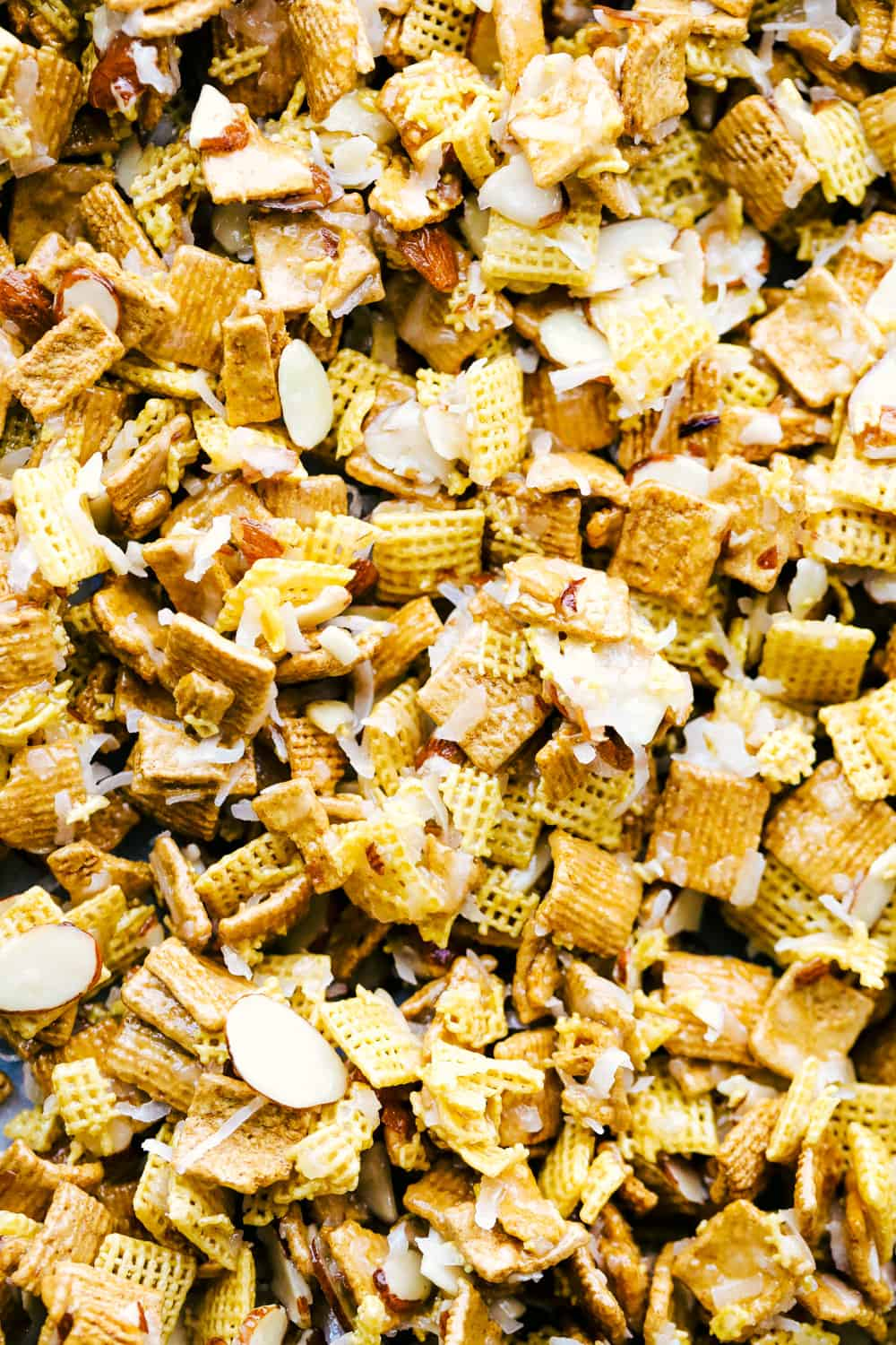 ooey gooey Chex mix up close on a pan.
