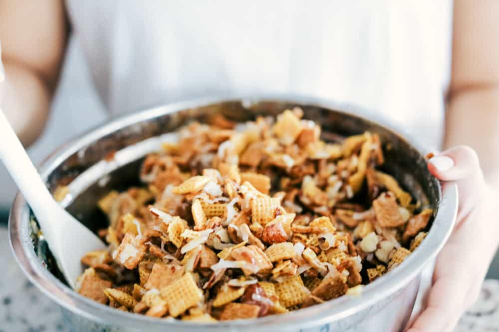 Ooey gooey Chex mix, mixed in a large bowl.