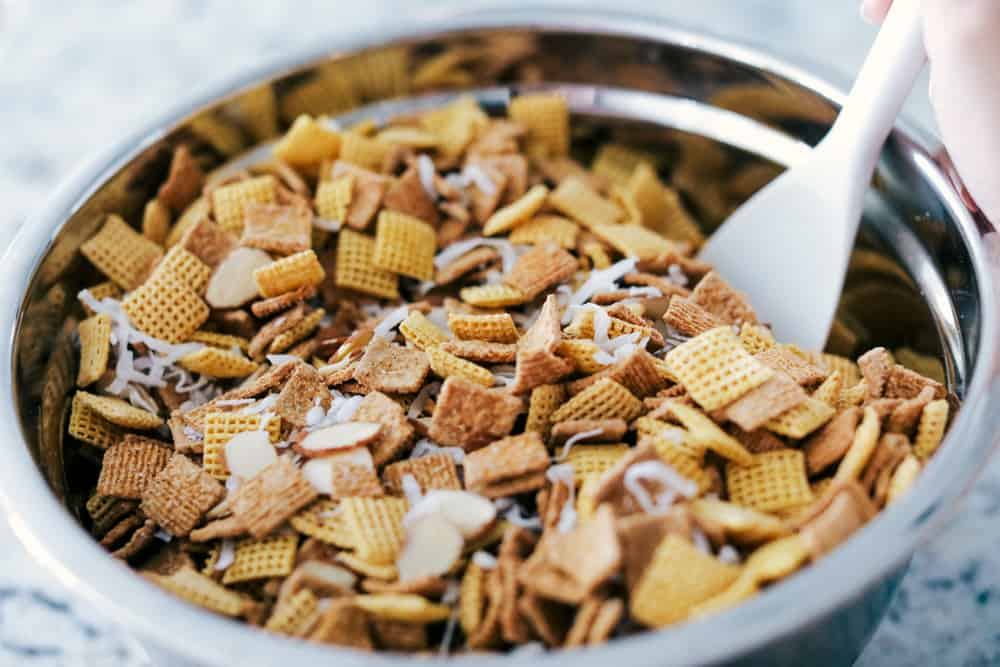 ooey gooey Chex mix mixed in a large bowl