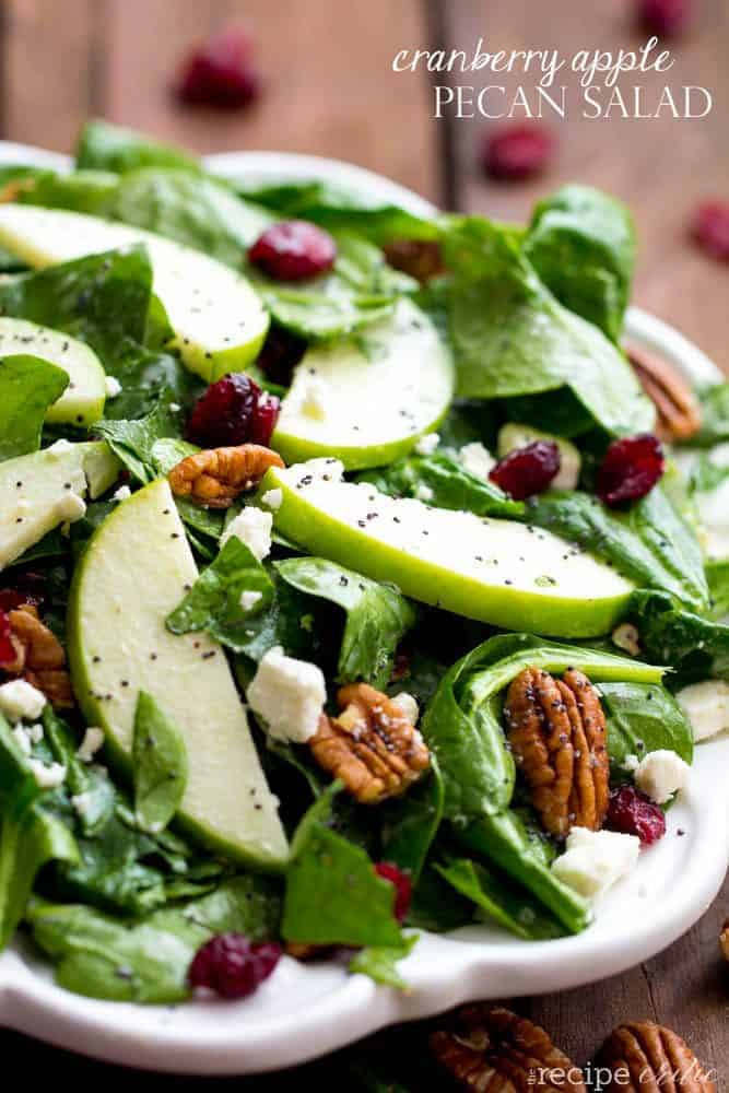 Cranberry apple pecan salad on a white plate.