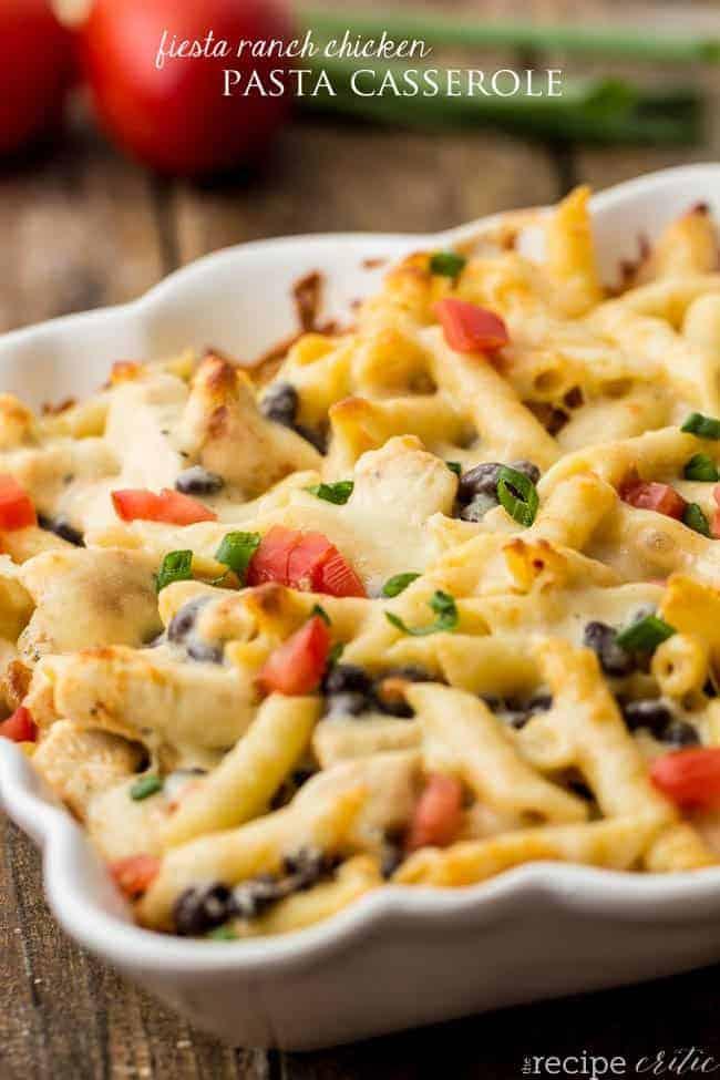Fiesta ranch chicken pasta casserole in a white casserole dish.