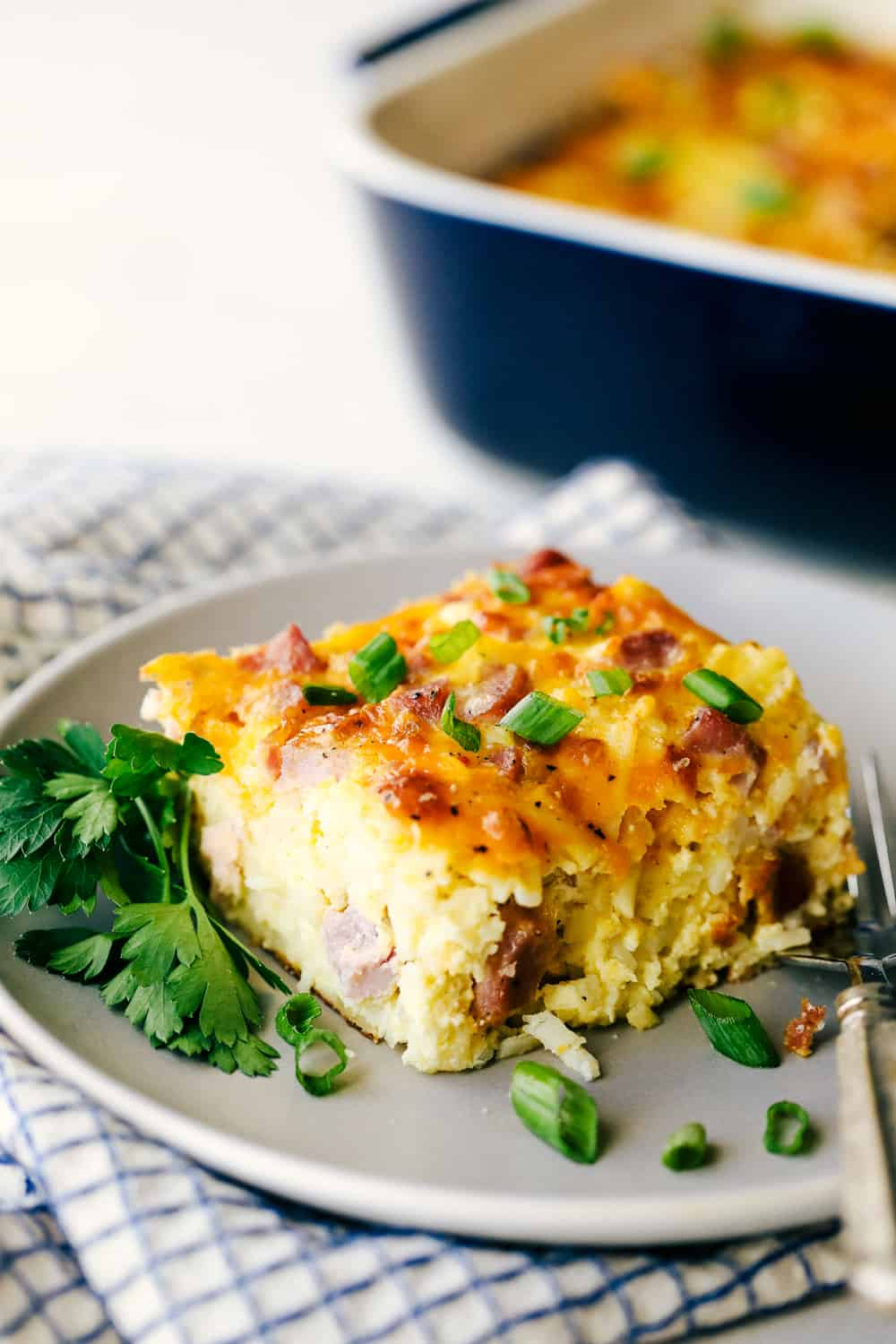 A slice of breakfast casserole on a plate.