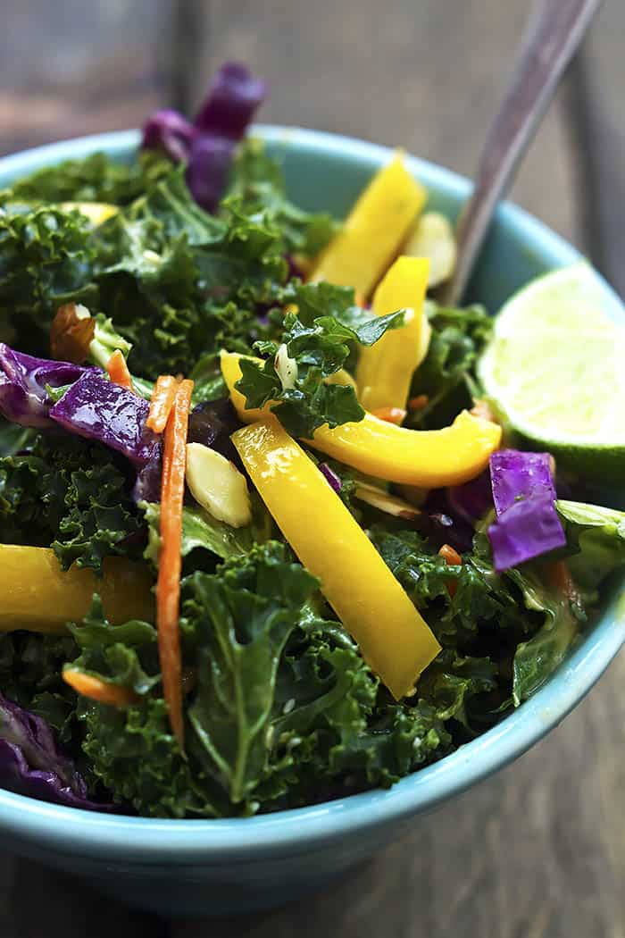 Crunchy Asian kale salad in a blue bowl.