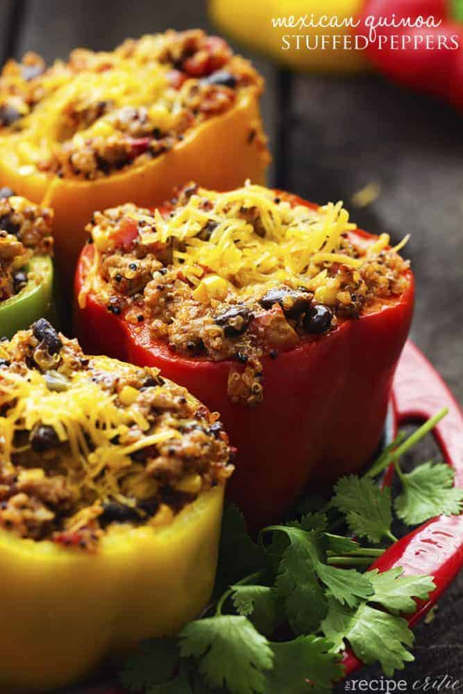 Mexican quinoa stuffed peppers on a red tray.