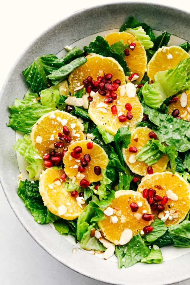 A salad with oranges and pomegranates and a zingy dressing.