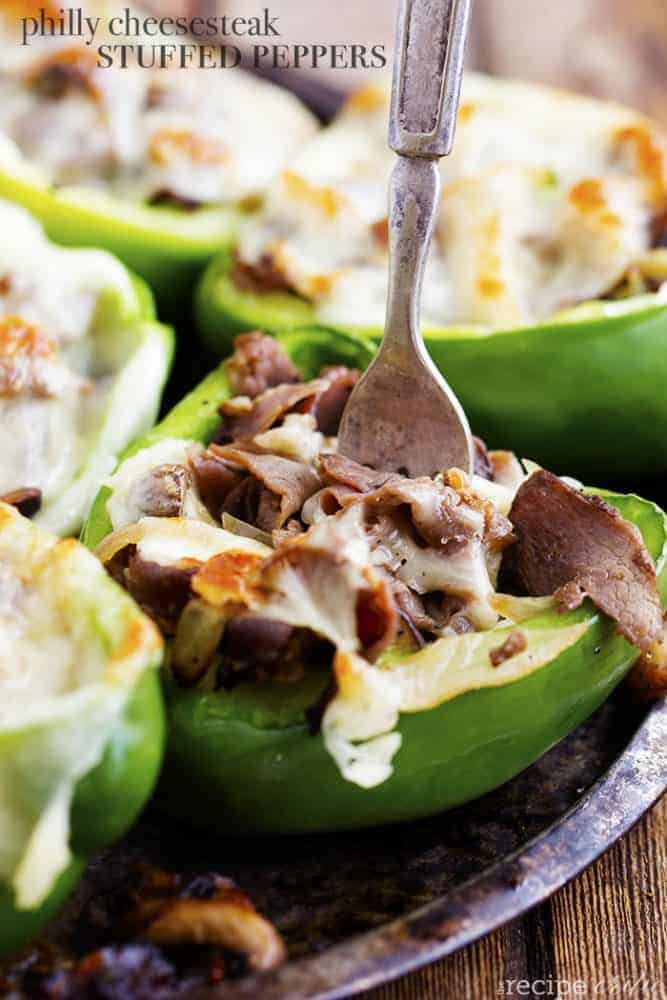 Philly cheese-steak stuffed peppers with a fork ready to enjoy.