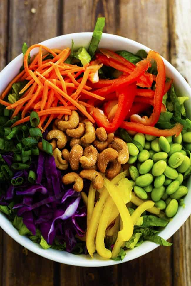 thai salad ingredients in a bowl ready to be mixed.