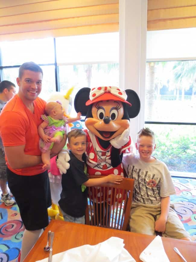 My husband, two boys and daughter with Minnie Mouse at a cafe in Disneyland.