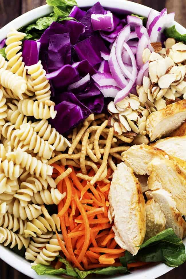 chicken chicken pasta salad ingredients on a white plate