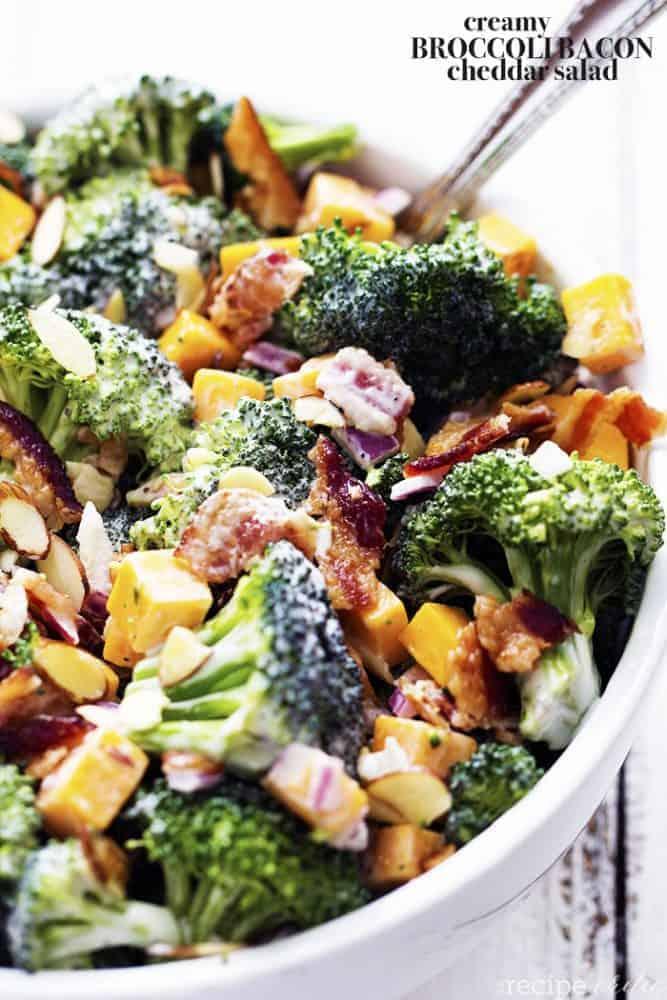 creamy broccoli salad in a white bowl.