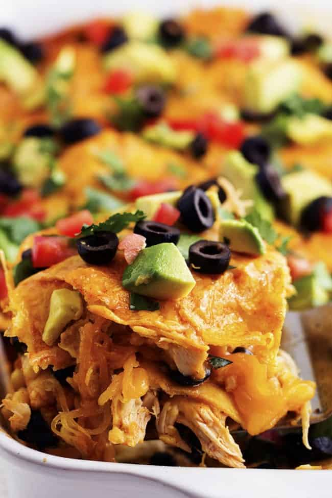 close up on a slice of stacked chicken enchiladas.