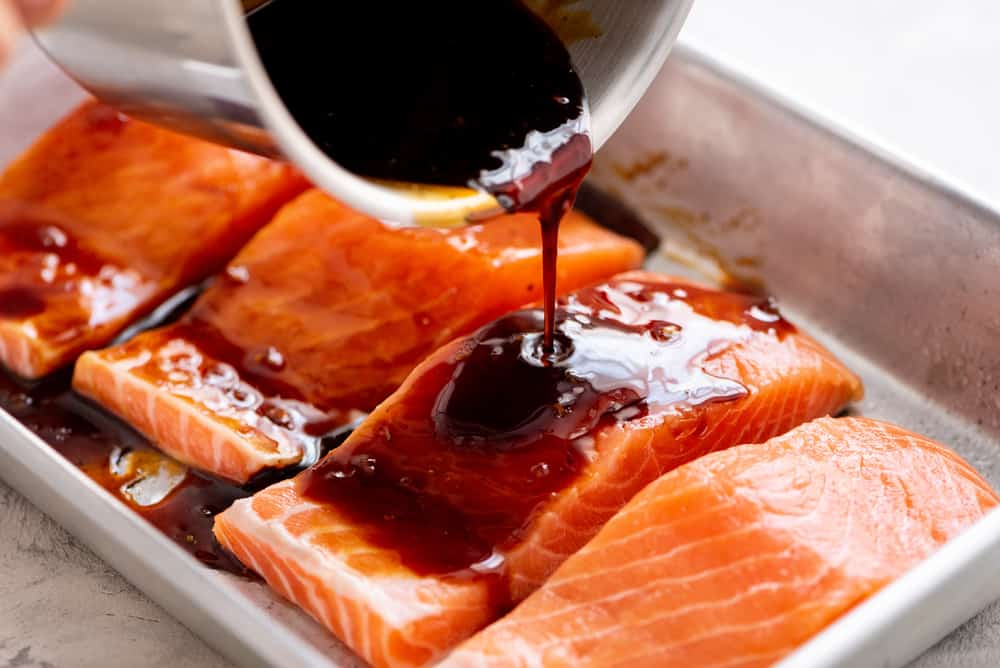 salmon with teriyaki sauce drizzled over it
