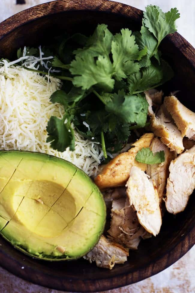avocado burrito ingredients in a wooden bowl.