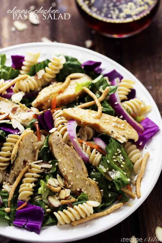 chinese chicken pasta salad on a white plate.