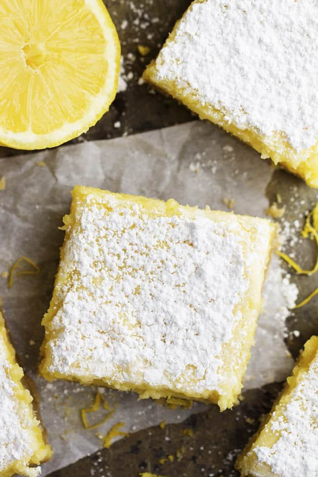 Areal view of lemon cheesecake bar with powdered sugar.