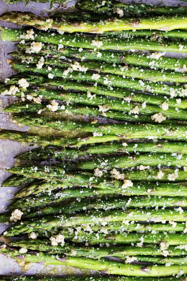 lemon garlic parmesan asparagus areal view on a tray.