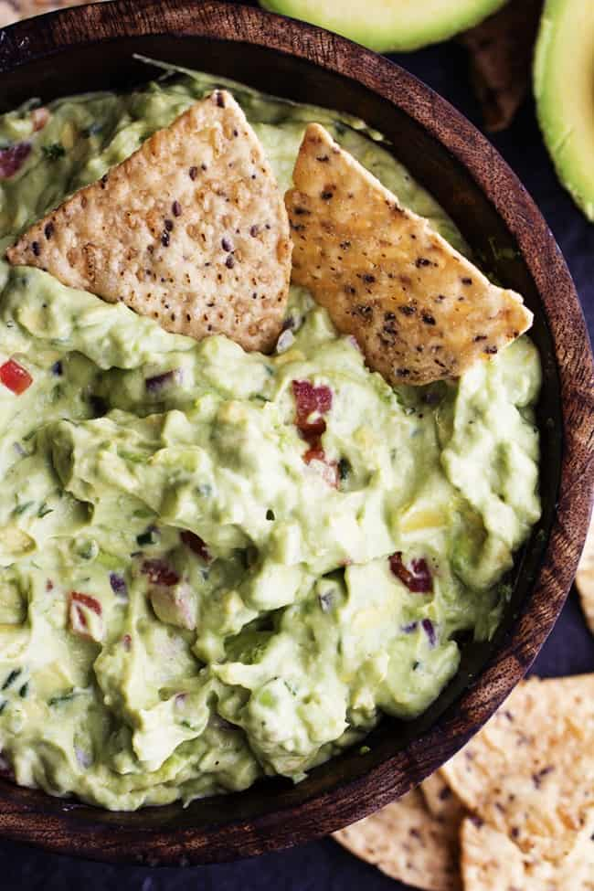 ranch guacamole in a bowl with 2 tortilla chips.