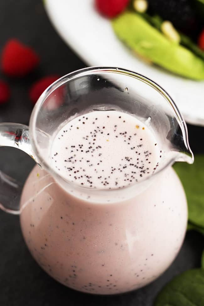 raspberry poppyseed dressing in a glass pitcher.