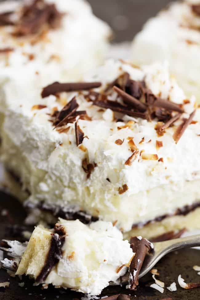 chocolate coconut cream pie bar bite on a fork.