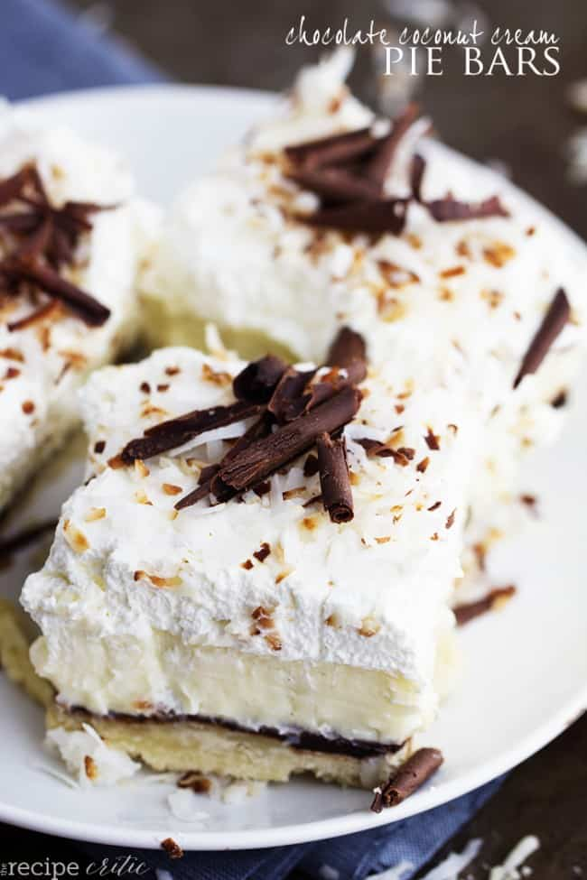 Chocolate coconut cream pie bars on a white plate.