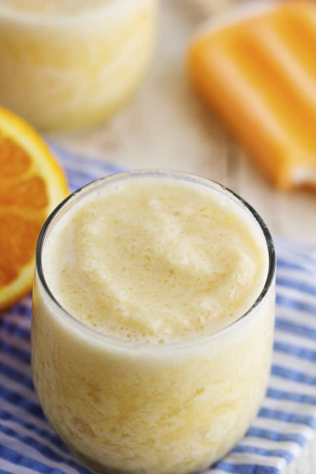 orange creamsicle smoothie in a glass.