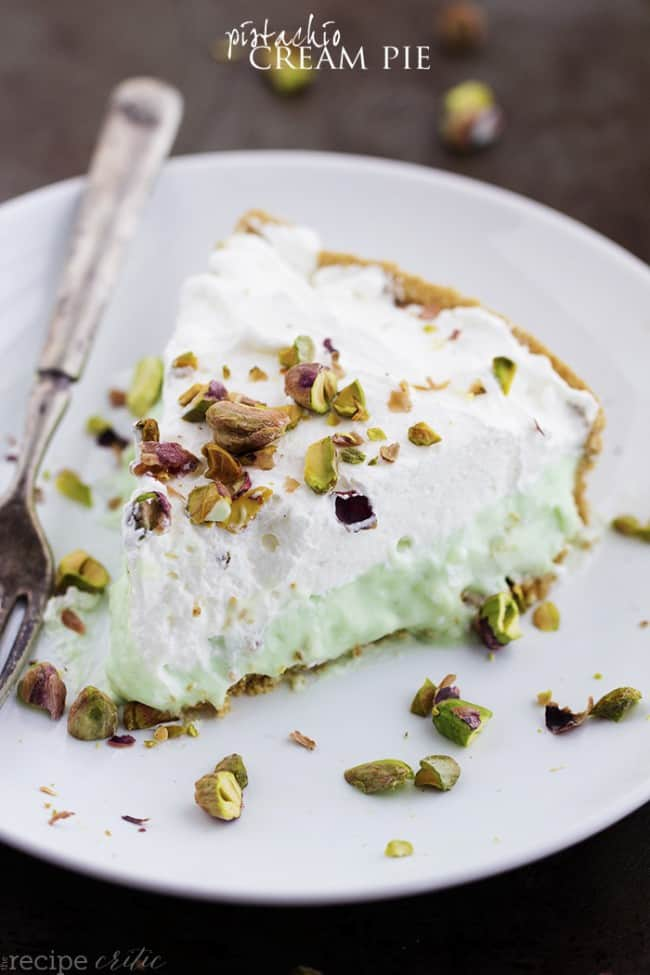 Slice of pistachio cream pie on a white plate.