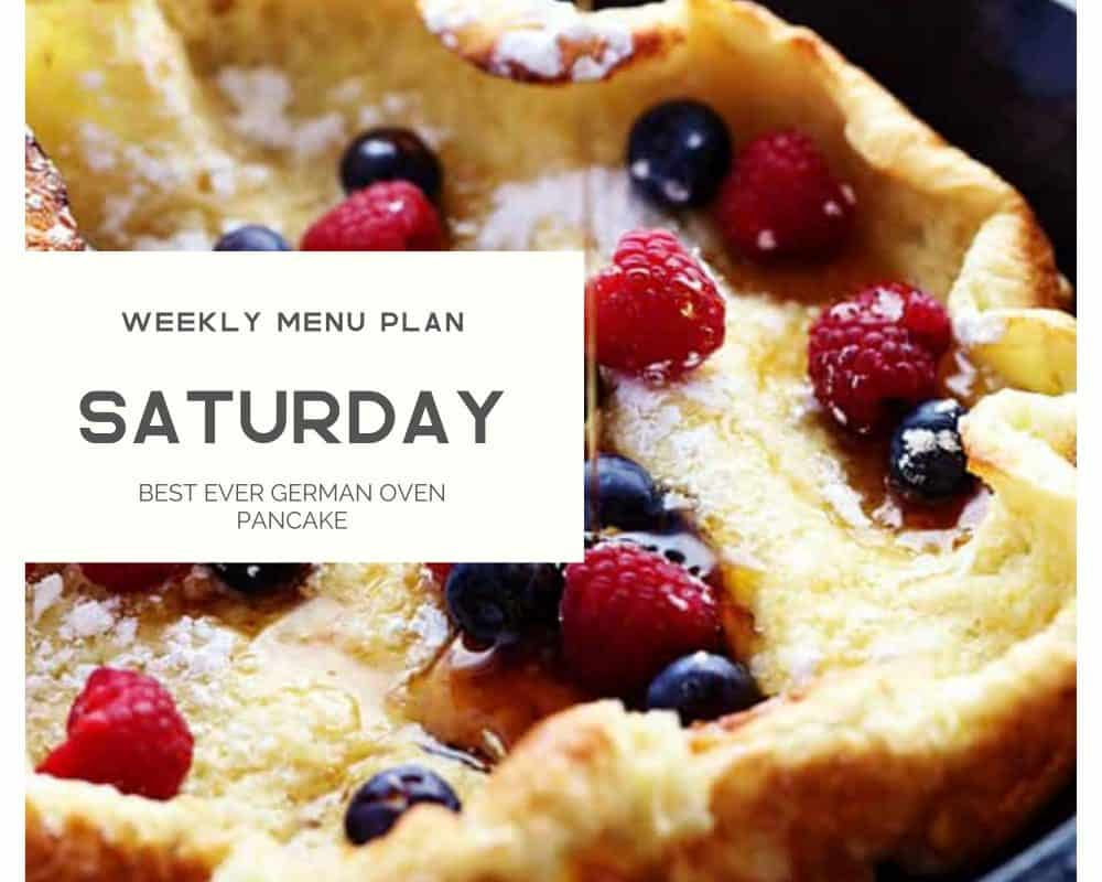 A photo of a German pancake with fresh berries and syrup being drizzled overtop with Saturday as a title for the weekly menu plan.