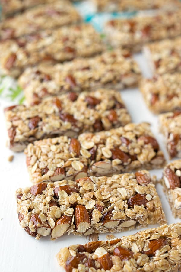 Almond granola bars laid in a row.