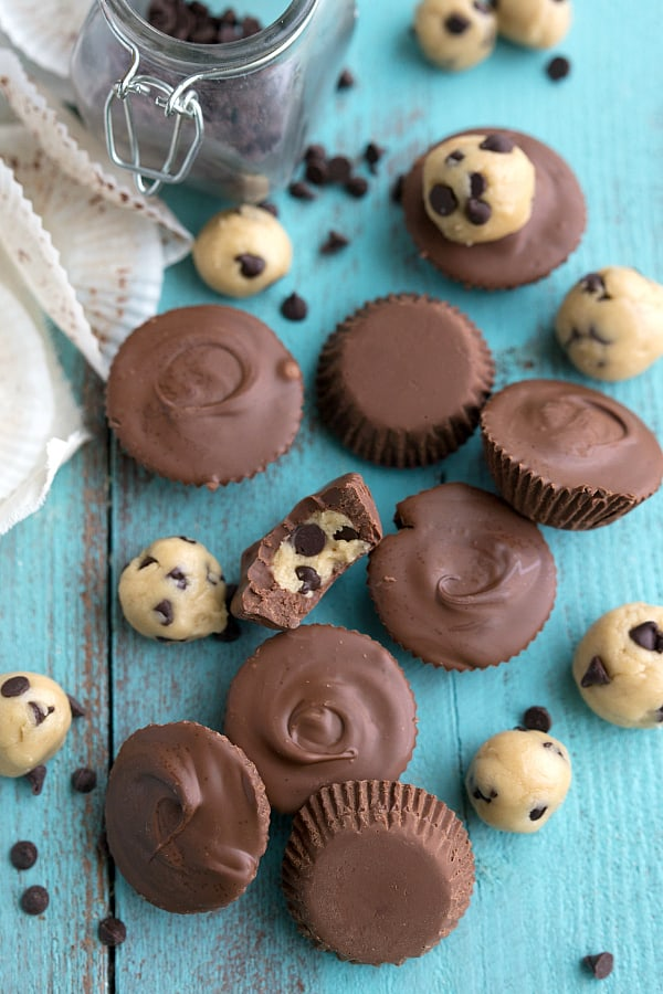 Cookie Dough Chocolate Cups on a blue table.