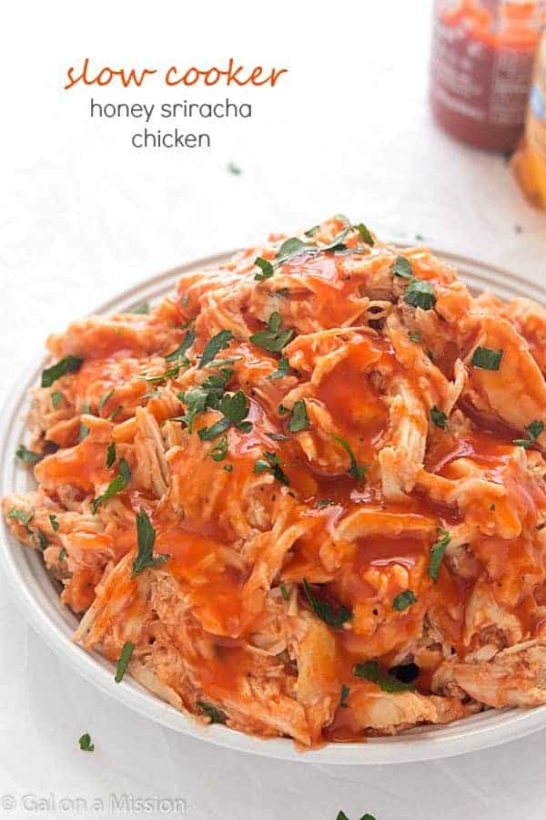 Slow Cooker Honey Sriracha Chicken - Moist and tender shredded chicken in an out-of-this world spicy and sweet sauce! Perfect for tacos, salads, or even sandwiches!