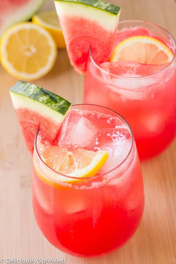 Watermelon Lemonade with watermelon and lemon on a wooden counter.