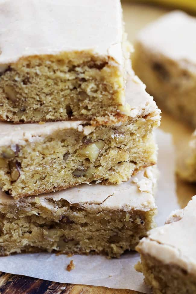 Close up side view of banana nut blondies in a stack.