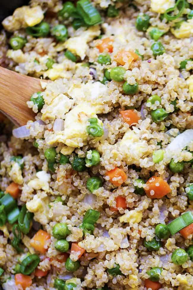 quinoa fried rice close up with wooden spoon.