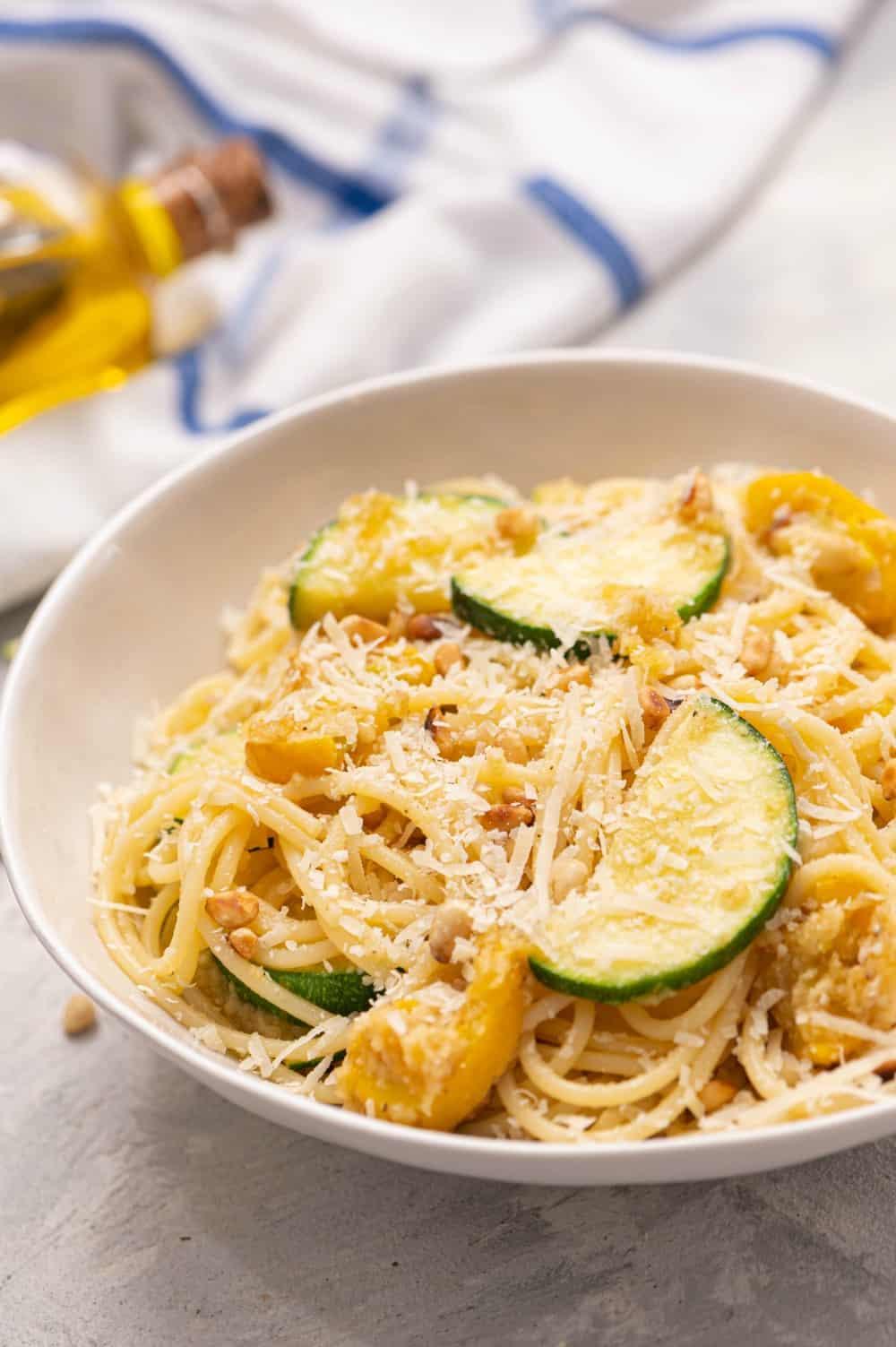 Summer squash lemon spaghetti in a white bowl.
