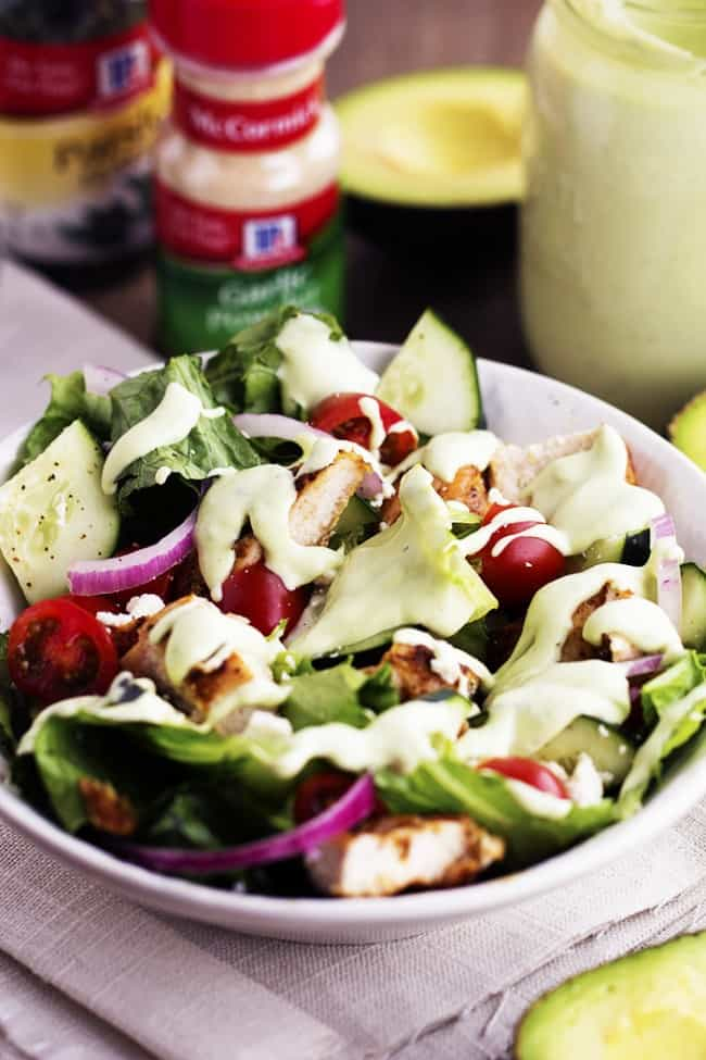 cajun salad in a white bowl with avocado ranch dressing.