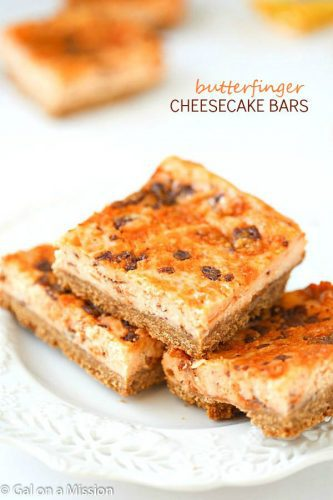 Butterfinger Cheesecake Bars - A crunchy graham cracker crust, then layered with an outrageous, creamy cheesecake mixed with chopped up butterfingers!