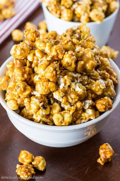 Oven Baked Caramel Corn in a white bowl.