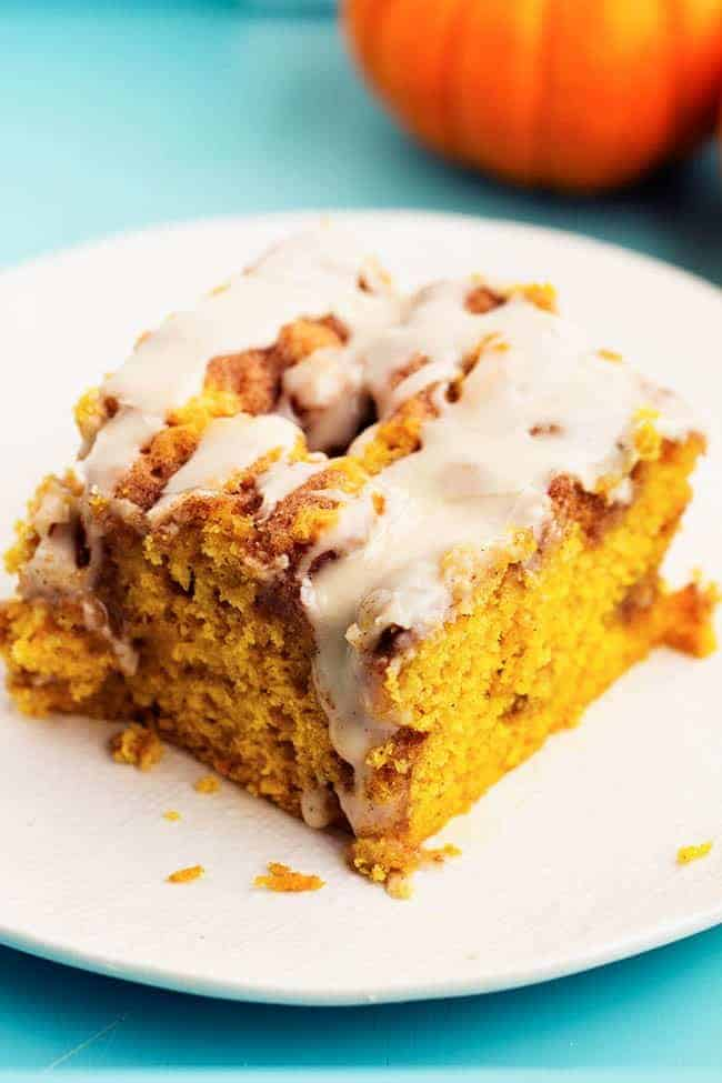 pumpkin cinnamon roll cake on a white plate.