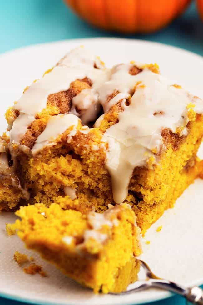A bite of pumpkin cinnamon roll cake on a fork.