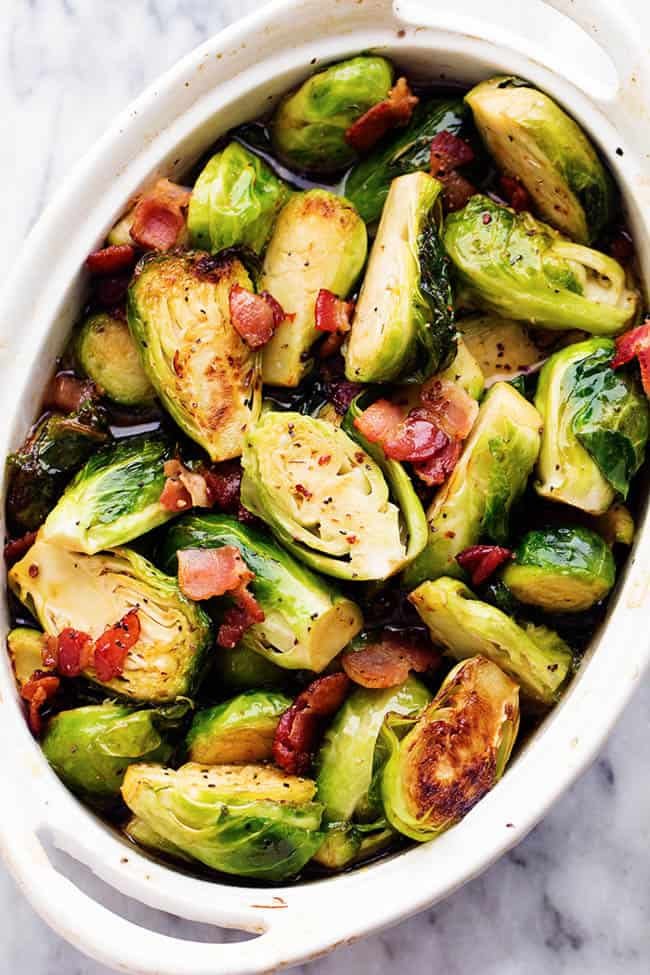 brussel sprouts in a white dish.