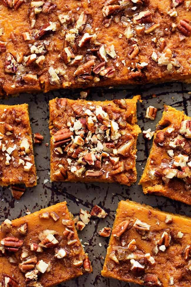 Pumpkin pecan pie bars cut into pieces.