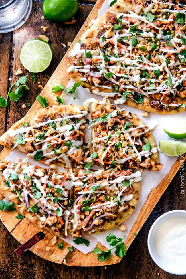 Thai Chicken Flatbread Pizza areal view on a wooden board.
