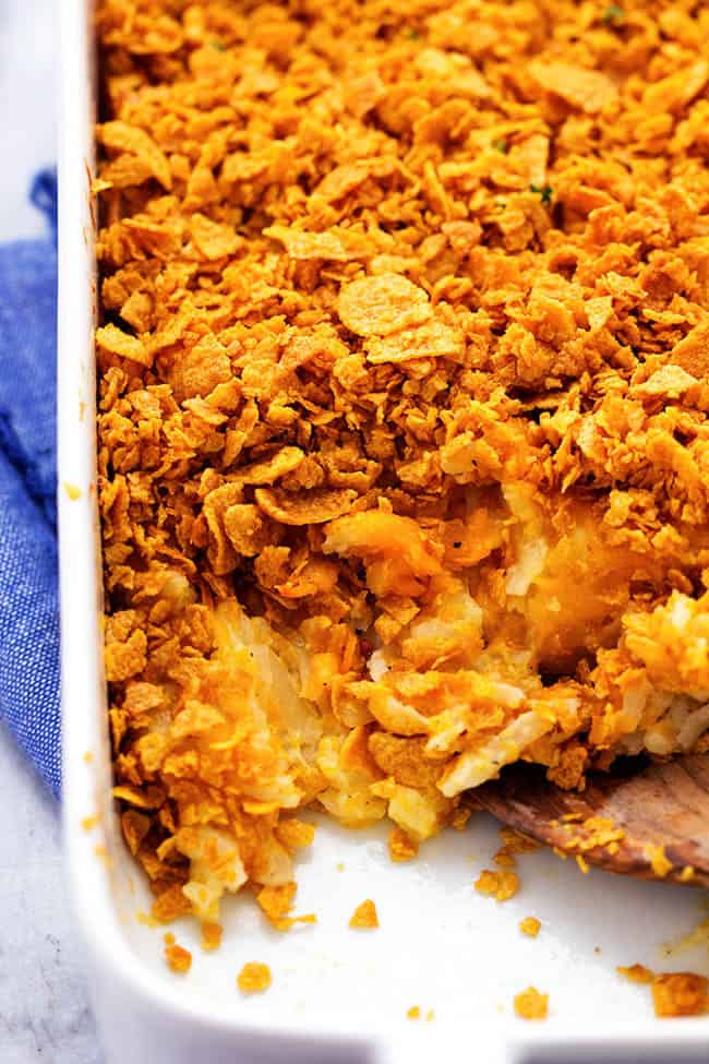 funeral potatoes in a white baking dish.