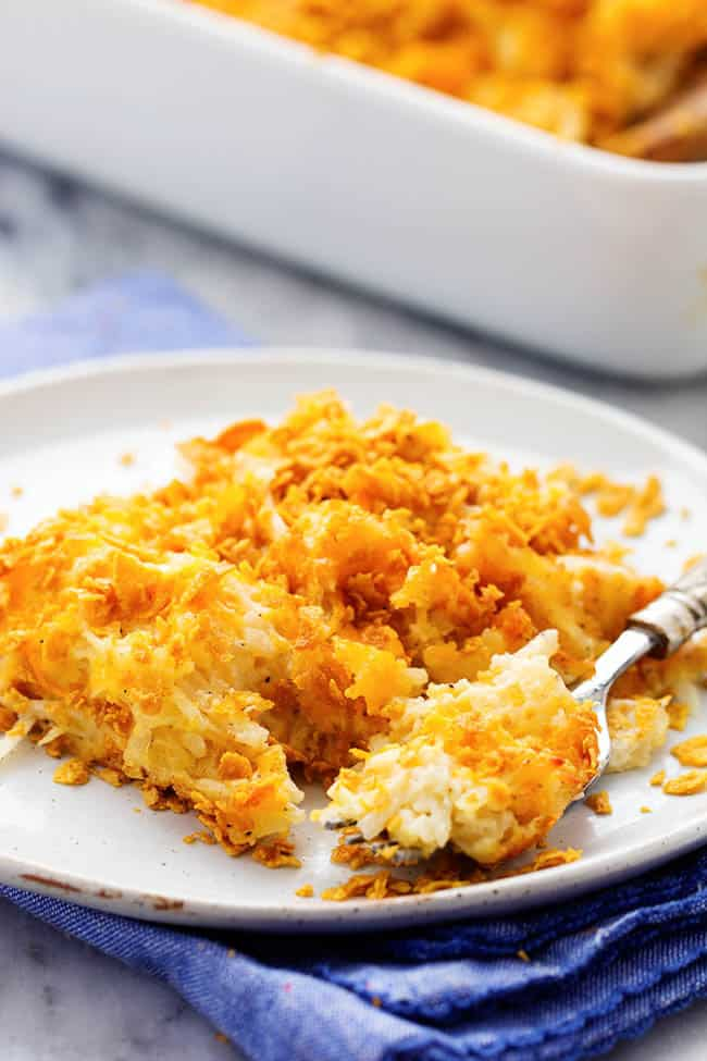 funeral potatoes on a white plate.